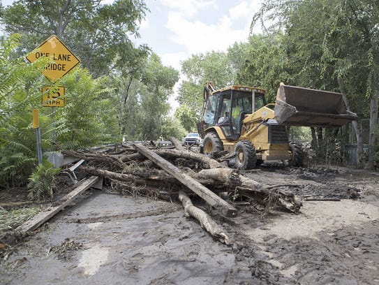 Yavapai County workers clean up the damage from the