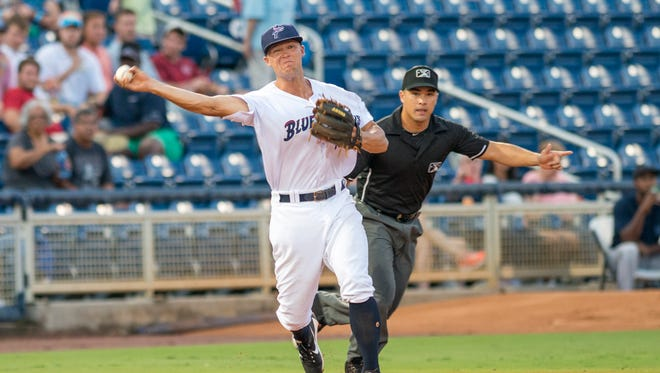 Third baseman Nick Senzel (13) tosses to first for an out during the Mobile BayBears vs the Pensacola Blue Wahoos baseball game in Pensacola on Friday, August 11, 2017.