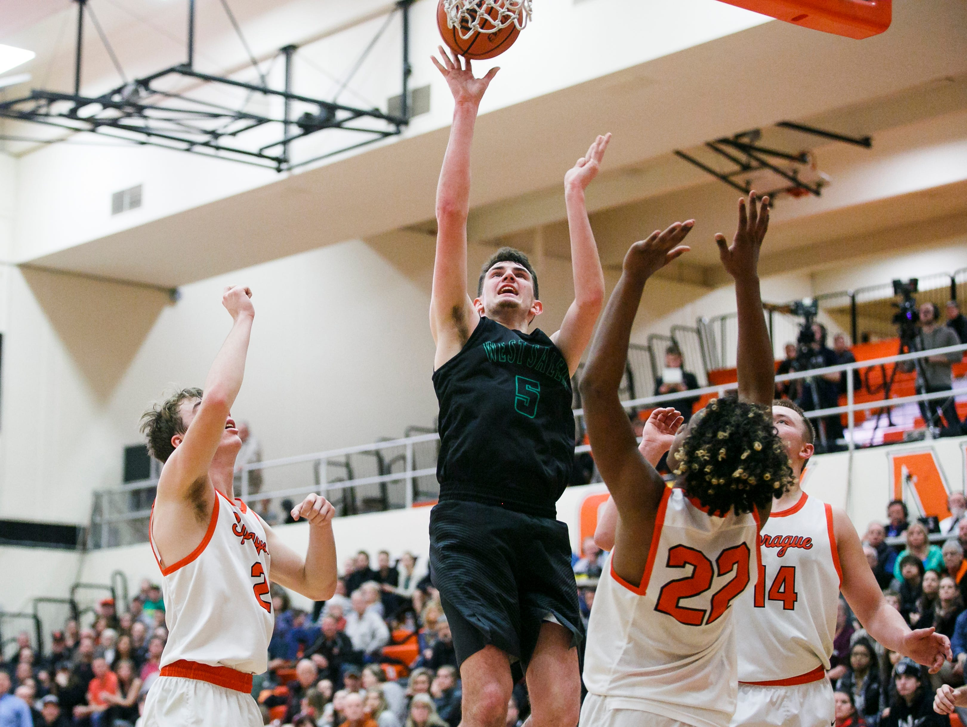 West Salem's Kyle Greeley (5) goes up for a basket against Sprague on Tuesday, Feb. 7, 2017, at Sprague High School. Sprague beat West Salem 71-65 to take first place in the Greater Valley Conference.