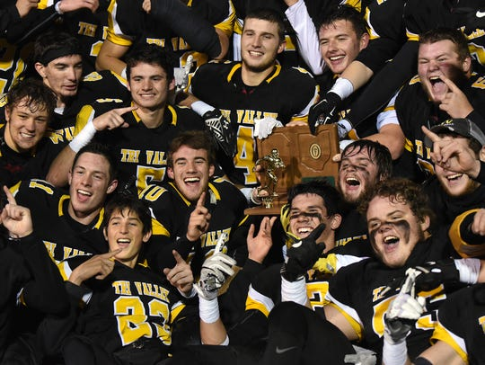 Tri-Valley football players pose with their regional