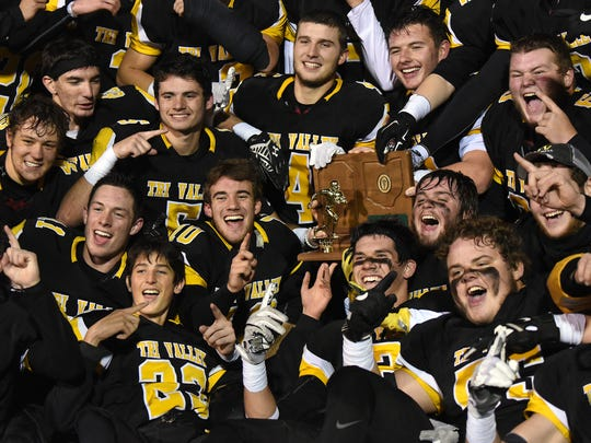 Tri-Valley football players pose with their regional trophy after defeated the Hawks of Bishop Hartley 13-9 on Friday, Nov. 17, 2017 at White Field in Newark.