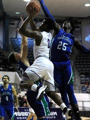 Abilene Christian's Jaylen Franklin (0) puts up a shot while being defended by Texas A&M Corpus Christi's Rashawn Thomas (25) during the first half of the Wildcats' game on Wednesday, Feb. 22, 2017, at ACU's Moody Coliseum.