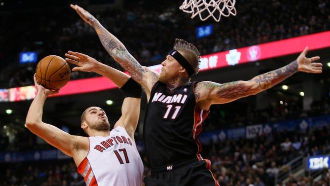 Miami Heat forward-center Chris Andersen (11) defends against Toronto Raptors center Jonas Valanciunas (17) during the first half at the Air Canada Centre.