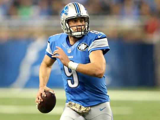 Lions quarterback Matthew Stafford looks to pass.