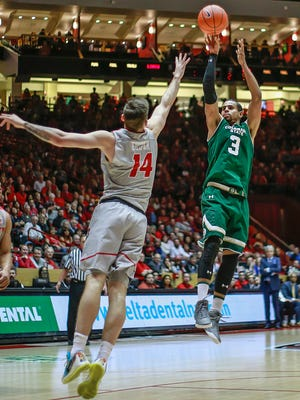 CSU's Gian Clavell shoots over New Mexico's Dane Kuiper during Tuesday night's game in Albuquerque, N.M. The Rams won for the eighth time in nine games to remain in a tie for first place in the Mountain West standings with three regular-season games remaining.