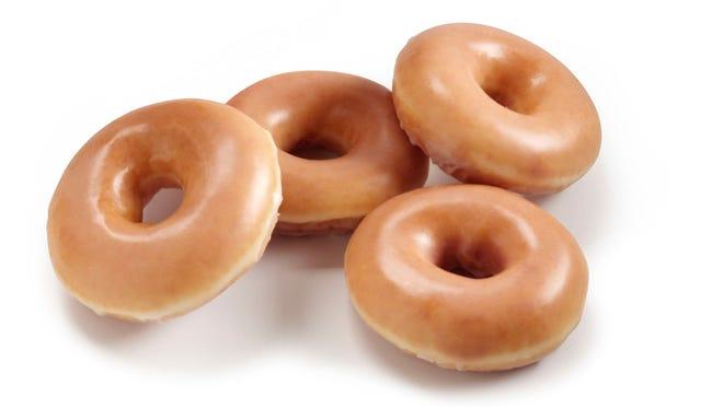 Krispy Kreme commemorates 1000th store with free doughnuts.