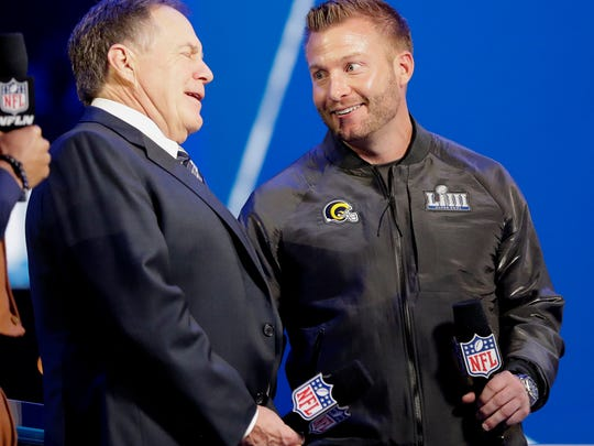 Los Angeles Rams head coach Sean McVay, right, speaks with New England Patriots head coach Bill Belichick during Opening Night for the NFL Super Bowl 53 football game Monday, Jan. 28, 2019, in Atlanta. (AP Photo/David J. Phillip)