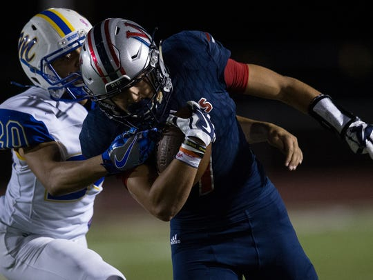 Veterans Memorial's Sethe Solis is brought down by