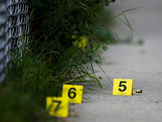 In this Sunday, Aug. 5, 2018 photo, evidence markers