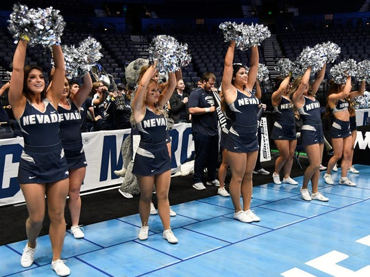 The Nevada cheerleaders cheer for their team during