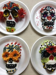 A selection of decorated sugar skulls by Jackie Hardin
