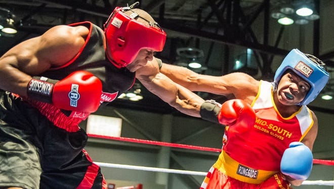 Travolta Johnson (right) takes on Trevin Childs from Indiana in the National Golden Gloves tournament held at the Cajundome Convention Center on Wednesday night May 3, 2017.
