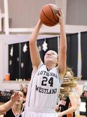 Lutheran Westland's Rachel Reddeman grabs one of her
