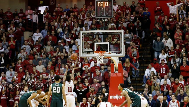 Indiana guard Yogi Ferrell misses the second free throw that would have tied the game with 2.0 seconds remaining in Saturday's game. MSU won, 74-72.