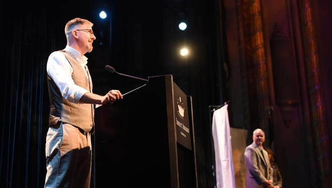 Dean Lowry, of Orchard House Bed and Breakfast in Granville, excepts the award for  new partner of the year during Explore Licking County's 2016 Impact Awards at The Midland Theatre on Tuesday evening.