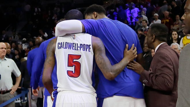 Detroit Pistons center Andre Drummond, right, and guard Kentavious Caldwell-Pope walk off of the court after Game 4 against the Cleveland Cavaliers on Sunday, April 24, 2016, in Auburn Hills.
