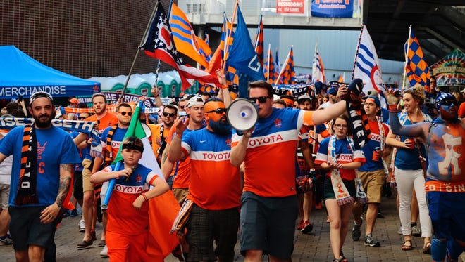FC Cincinnati supporters march into Nippert Stadium for the Saturday, April 15 home opener against St. Louis FC.