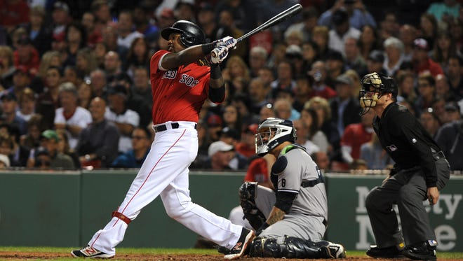 Sep 16, 2016; Boston, MA, USA; Boston Red Sox first baseman Hanley Ramirez (13) hits a home run during the fourth inning against the New York Yankees at Fenway Park. Mandatory Credit: Bob DeChiara-USA TODAY Sports