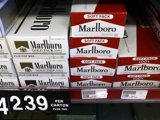 Cartons of cigarettes sit on shelves at Discount Smoke Shop in Ballwin. Missouri's tobacco tax will rise if at least one of two ballot measures passes in November.