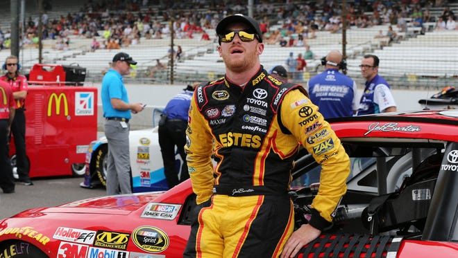 Jeb Burton waits by his car during Sprint Cup qualifying at Indianapolis Motor Speedway.