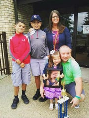 Elliana Nelson, 6, poses with her family after Ontario