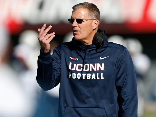Connecticut head coach Randy Edsall gives instructions against Cincinnati during the first half of an NCAA college football game, Saturday, Nov. 25, 2017, in Cincinnati. (AP Photo/Gary Landers)