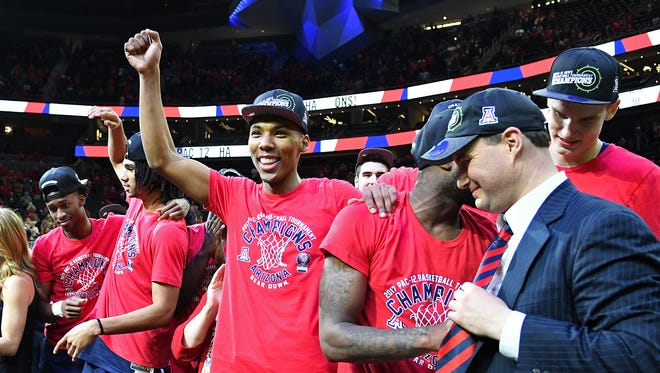 Mar 11, 2017: The Arizona Wildcats guard Allonzo Trier (35) cheers as team mates celebrate on a stage after defeating the Oregon Ducks 83-80 in the Pac-12 Conference Championship game at T-Mobile Arena.