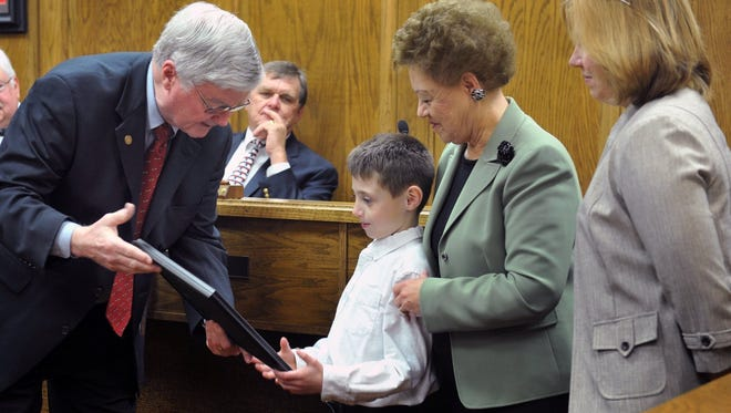 Wichita County Judge Woody Gossom talks with Cody Brock and his family at a special presentation for Absolutely Incredible Kids Day in 2015. This year's letter-writing campaign will be March 15.