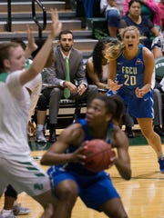 FGCU's Haley Laughter (20) calls for the ball as Tytionia Adderly backs down Stetson's Sarah Sagerer in the lane in the first half of action during the Atlantic Sun championship game at the Edmunds Center Sunday, March 12, 2017 in DeLand, Fla.