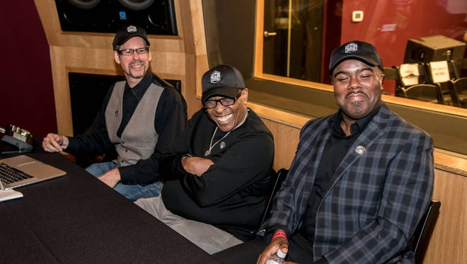 Made in Memphis Entertainment's CEO David Porter (center), and A&R head Hamilton Hardin (right) listen to some new tracks during Monday's launch event.
