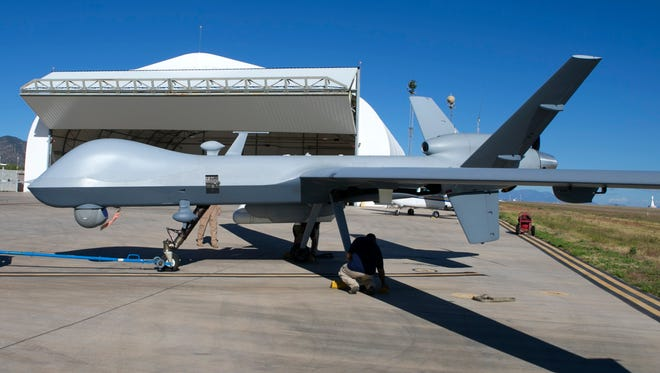 """""""Predator B"""" unmanned aircraft at the Fort Huachuca U.S. Army installation in Sierra Vista, Ariz., on Thursday, June 11, 2015. The drone was about to take off for a surveillance mission on the U.S. border with Mexico."""