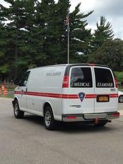 Monroe County Medical Examiner's van leaves Riverside