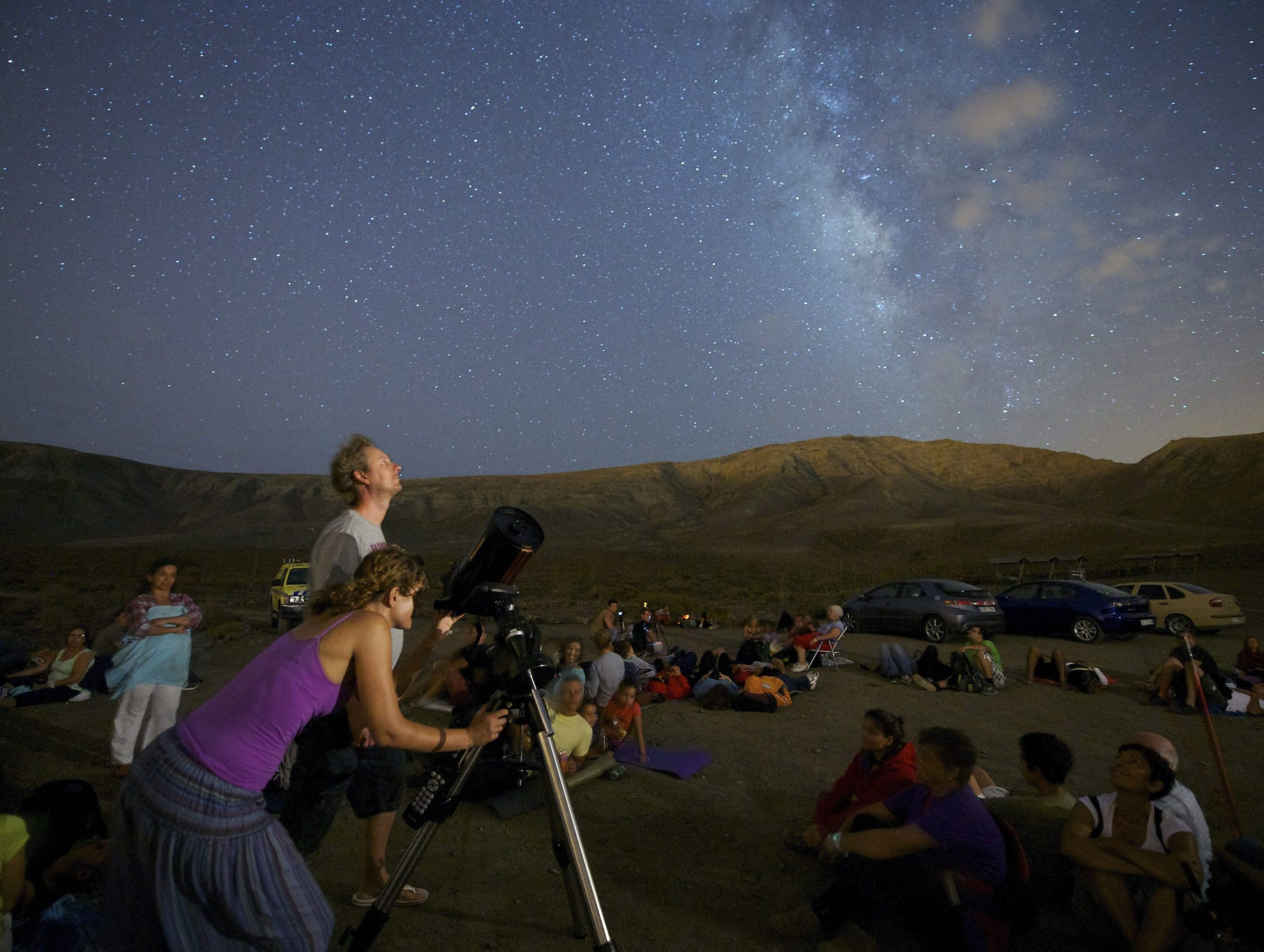 Stargazers observe the Perseid meteor shower in Atalayita, Canary Islands, Spain.
