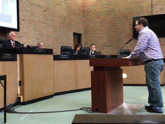 Aaron Green, 34, of Troy tells council they did the right thing in firing Kischnick in Troy, Mich., Sunday, March 11, 2018.  But Green and others said they wanted more transparency from the city about earlier unrelated allegations against Kischnick.