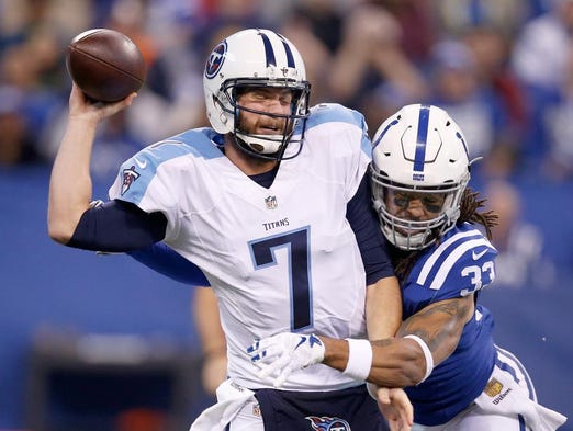 Colts safety Dwight Lowery hits Titans quarterback
