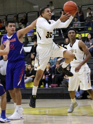 Alamogordo's Wellington Balsley glides toward the basket Tuesday night at the Tiger Pit.