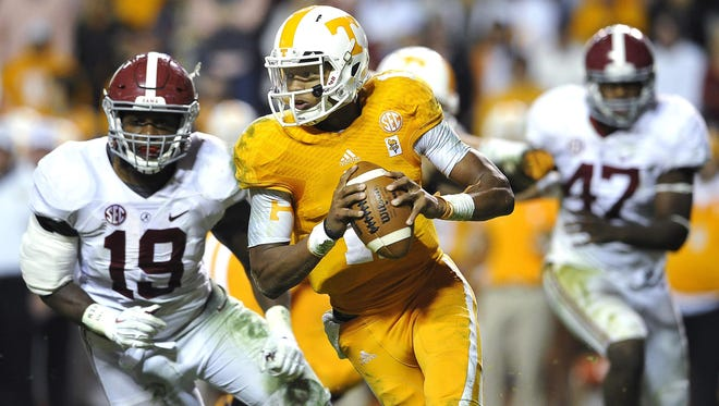 Tennessee quarterback Josh Dobbs, pictured here in his 2014 debut against Alabama, shrugs off suggestions that his practice performance early last season was lacking.