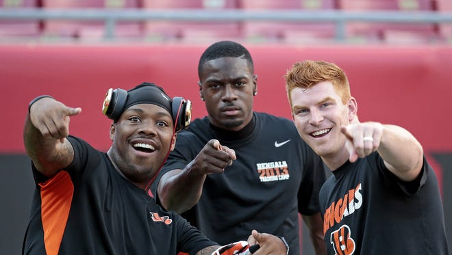 Cincinnati Bengals running back Jeremy Hill (32), wide receiver A.J. Green (18) and quarterback Andy Dalton (14) joke around during warm ups before kickoff of the NFL pre-season game between the Cincinnati Bengals and the Tampa Bay Buccaneers at Raymond James Stadium in Tampa, Florida, on Monday, Aug. 24, 2015.