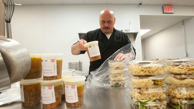 Chef Arpi Lengyel prepares GMeals on Wheelsnutritious gourmet food packages for delivery to seniors seniors who struggle with finances and are on waiting lists for food assistance13 June, 2016