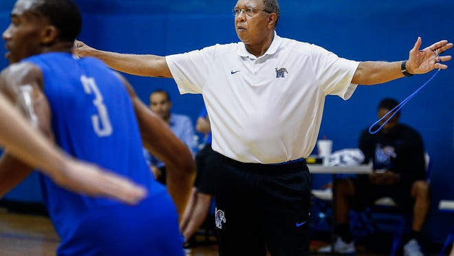 University of Memphis head coach Tubby Smith watches his team during an open practice at the Larry O. Finch Center.