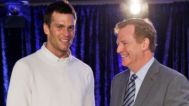 In this Feb. 2, 2015, file photo, New England Patriots quarterback Tom Brady poses with NFL Commissioner Rodger Goodell during a news conference after NFL football's Super Bowl XLIX in Phoenix, Ariz. Brady grew from a sixth-round draft choice into one of the best quarterbacks in NFL history. On Tuesday, NFL commissioner Roger Goodell hears Brady's appeal of a four-game suspension for using deflated footballs in the AFC championship game. How will that affect Brady's legacy?