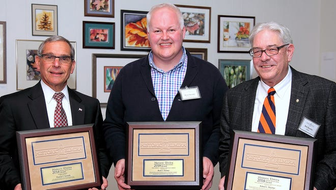Historic Elmira Inc. handed out its annual Preservation Awards on Wednesday. From left, award winners Tom Santulli, Brent Stermer and Robert Butcher.