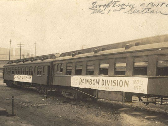 Train carrying members of the 167th Infantry Regiment Rainbow Division of the American Expeditionary Forces after World War I