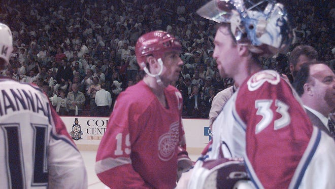 Detroit Red Wings captain Steve Yzerman, left, shakes hands with  Colorado Avalanche goalie Patrick Roy ... sometime.