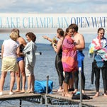 Tori Lamphere of Jericho pulls her daughter Lila, 3, to shore with her at the end of an open water race on Lake Champlain on Sunday. Lila was waiting at the end of a 3.7-mile race from Essex, N.Y., to Charlotte.