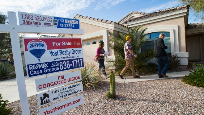 Megan and Kirk Scallon follow real-estate agent John Gluch as they look for their first home to purchase in Casa Grande on  Tuesday, March 11, 2014.
