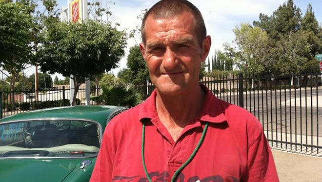 In this photo taken on Thursday, May 29, 2014, Joe Cornell poses for a photo in Fresno, Calif. Cornell, who returned a bag full of about $125,000 that fell out of Brinks truck, received a $5,000 reward and Brinks will make a separate $5,000 donation to the Salvation Army. (AP Photo/The Fresno Bee,  George Hostetter) LOCAL PRINT OUT (VISALIA TIMES-DELTA, REEDY EXPONENT, KINGBURG RECORDER, SELMA ENTERPRISE, HANFORD SENTINEL, PORTERVILLE RECORDER, MADERA TRIBUNE, THE BUSINESS JOURANL FRENSO); LOCAL TV OUT (KSEE24, KFSN30, KGE47, KMPH26)