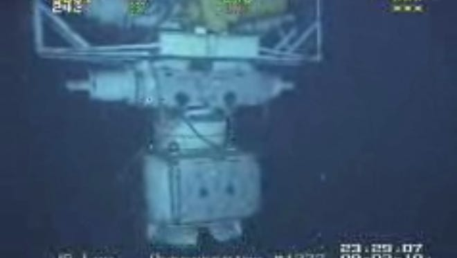 In this image taken from video provided by BP  PLC at 12:23 a.m. EDT, Saturday Sept. 4, 2010 Aug. 3, 2010 shows the blowout preventer that failed to stop oil from spewing into the Gulf of Mexico being raised to the surface. The last-ditch safety device that didn?'t stop the 2010 BP oil spill.