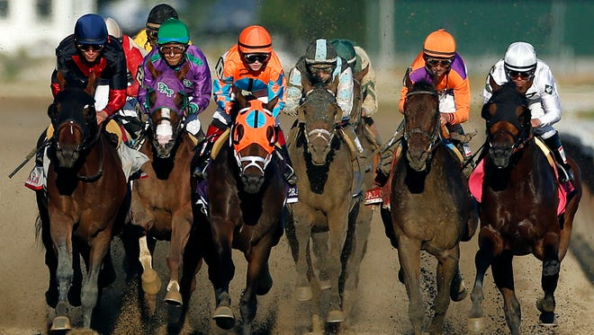 California Chrome, second from left, runs in traffic behind Tonalist, left, and General A Rod (10) as they head down the backstretch during the 146th running of the Belmont Stakes  at Belmont Park on Saturday in Elmont, N.Y.  Tonalist went on to win the race, denying California Chrome the Triple Crown victory.