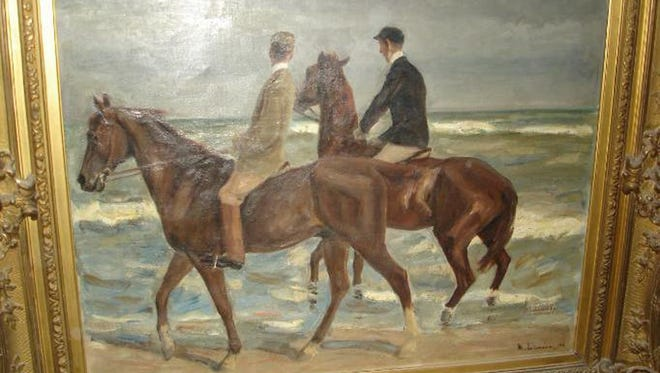 Photo provided by the Augsburg, southern Germany, prosecution from Nov. 12, 2013 shows a painting 'Reiter am Strand' ('Riders at the Beach') by German artist Max Liebermann from 1901 that was among the more than 1400 art works that were seized by German authorities in an apartment in Munich in February 2012.